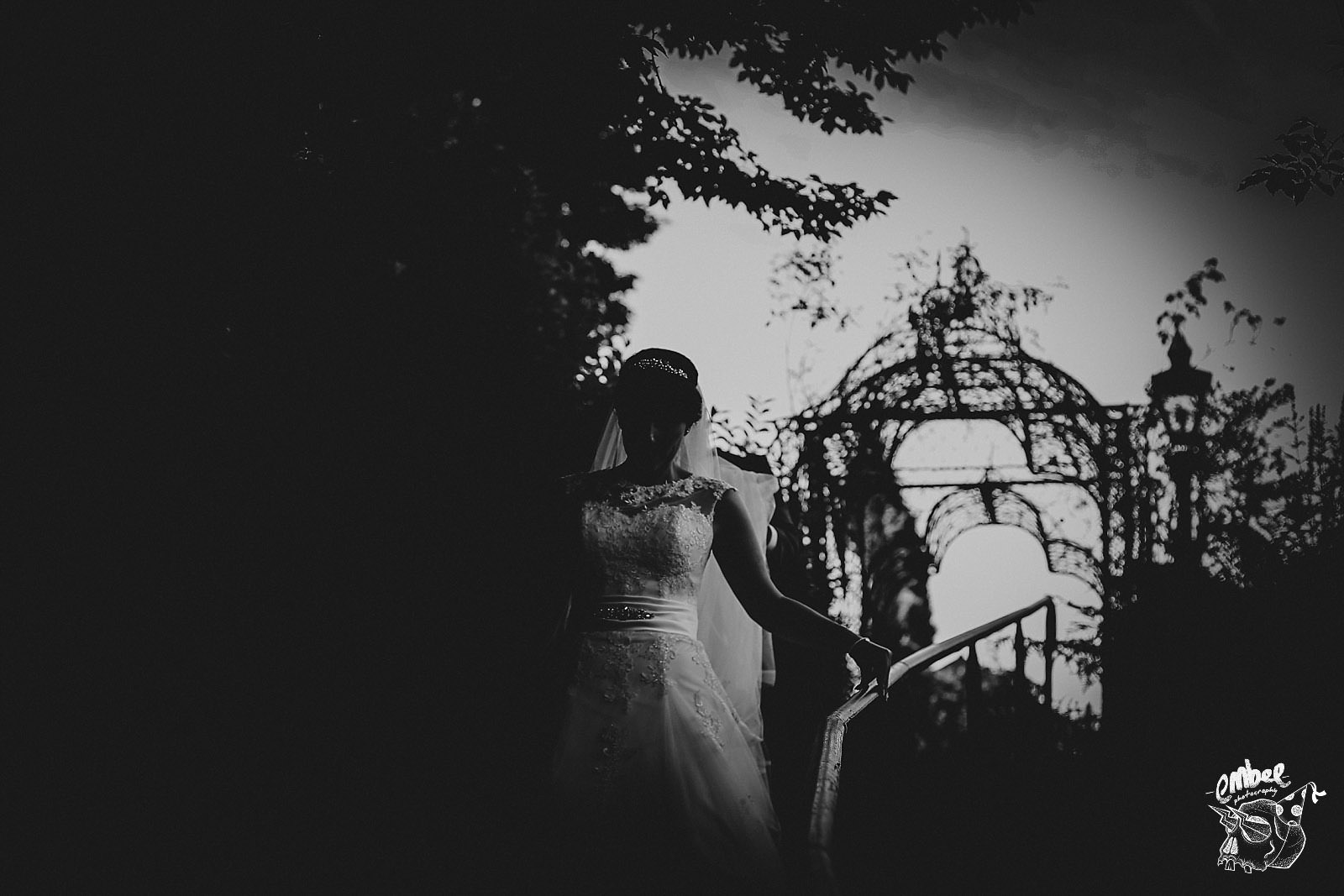 artistic shot of bride walking down some stairs