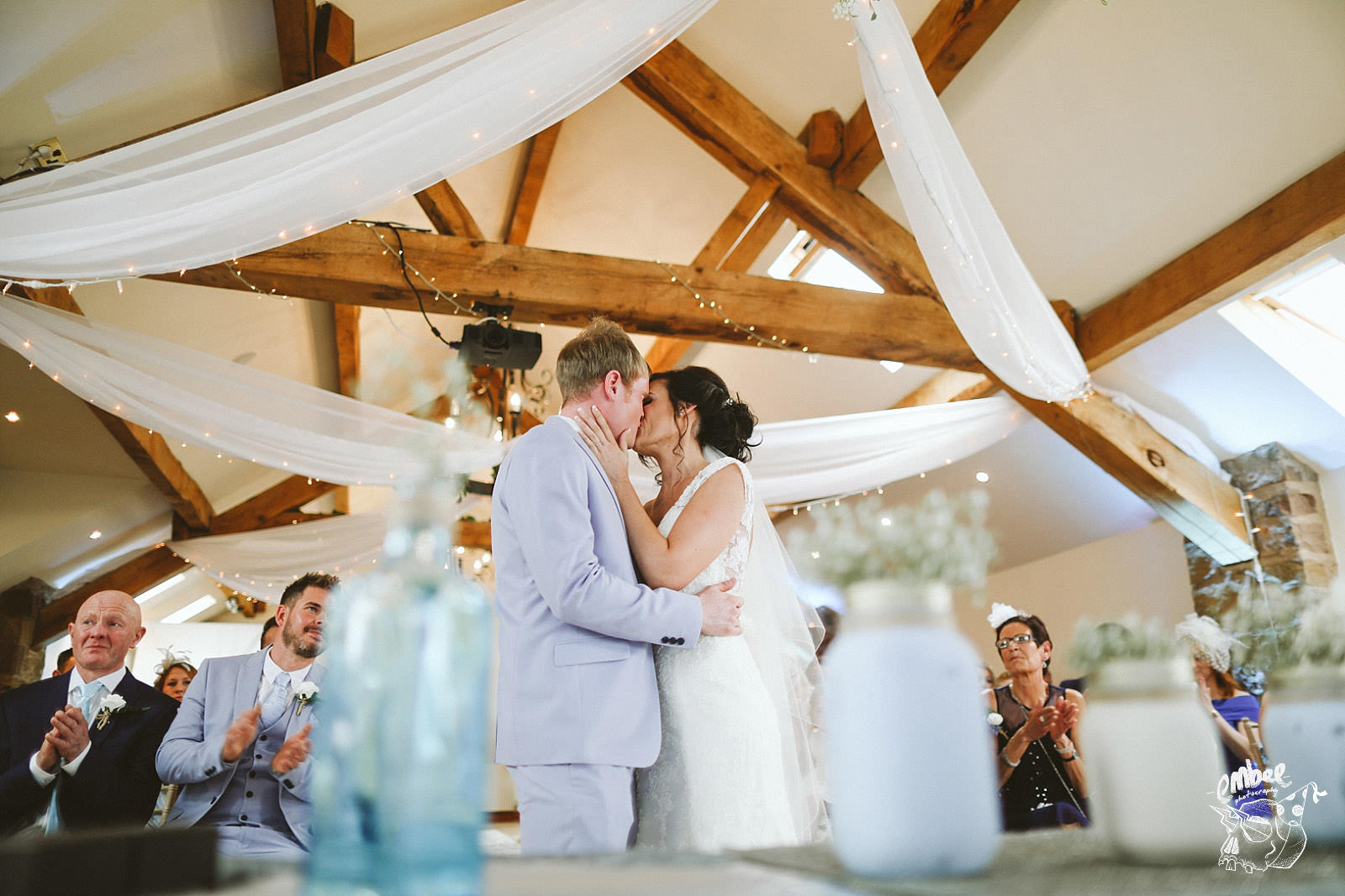 bride and groom kiss after tying the knot