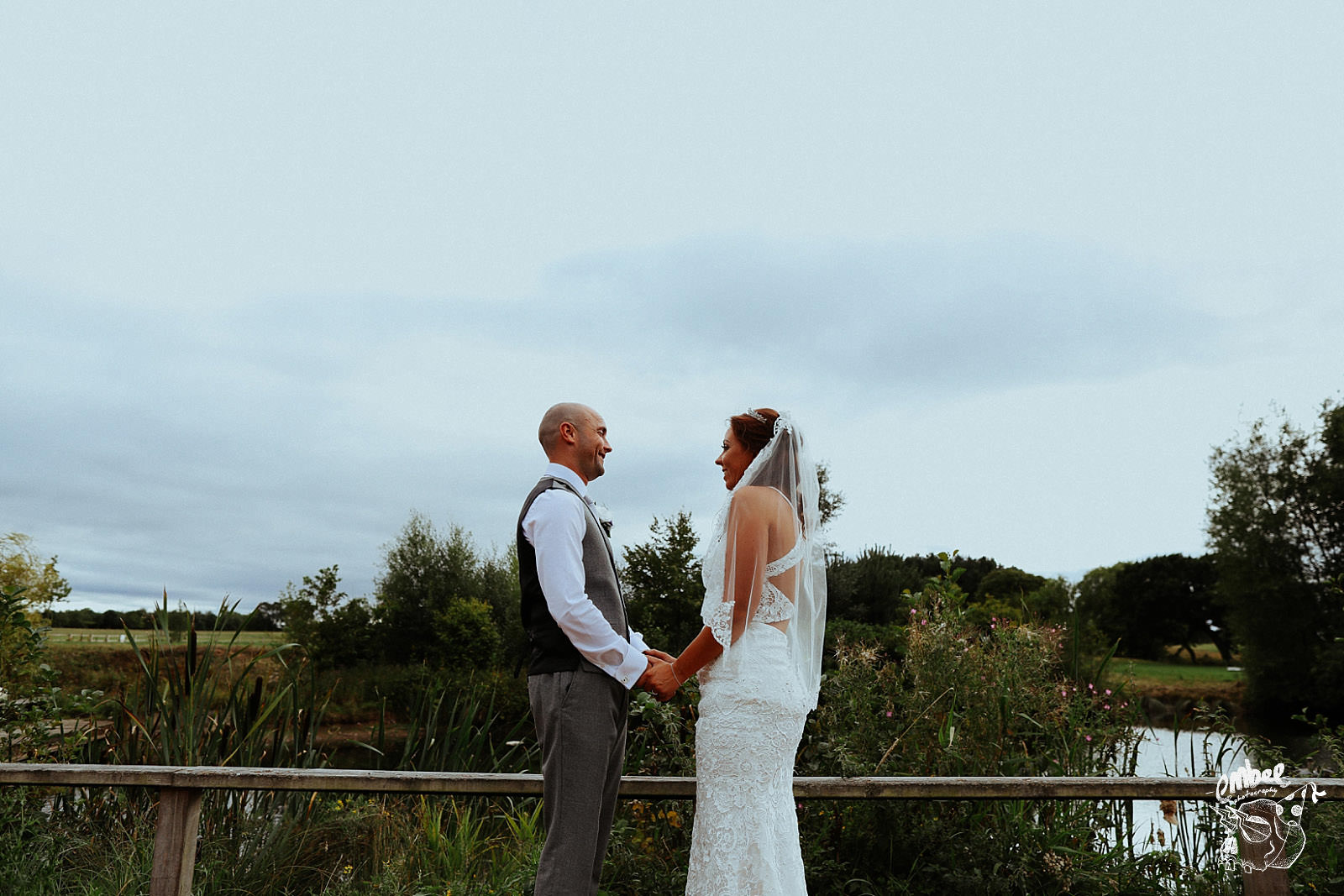laughing bride and groom at hurlston hall