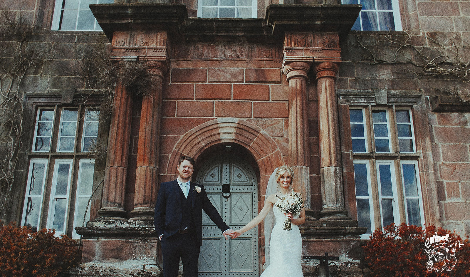 bride and groom hold hands at this lancashire wedding venue
