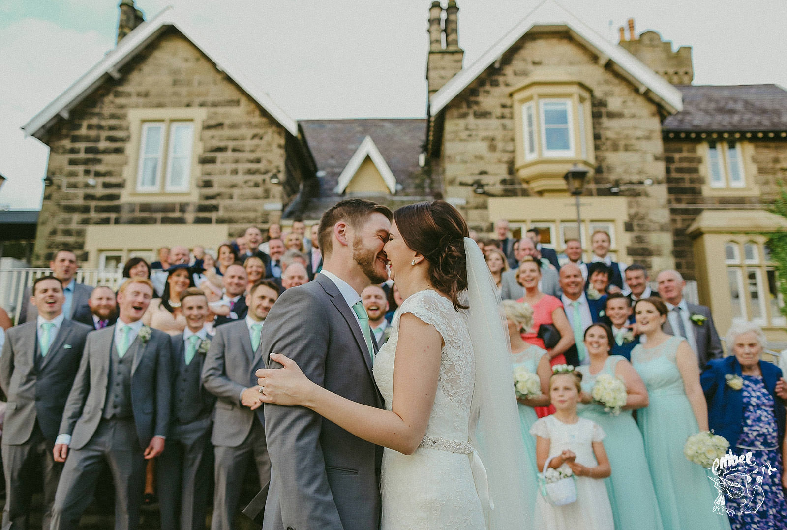 bride and groom kiss on the steps at west tower wedding venue
