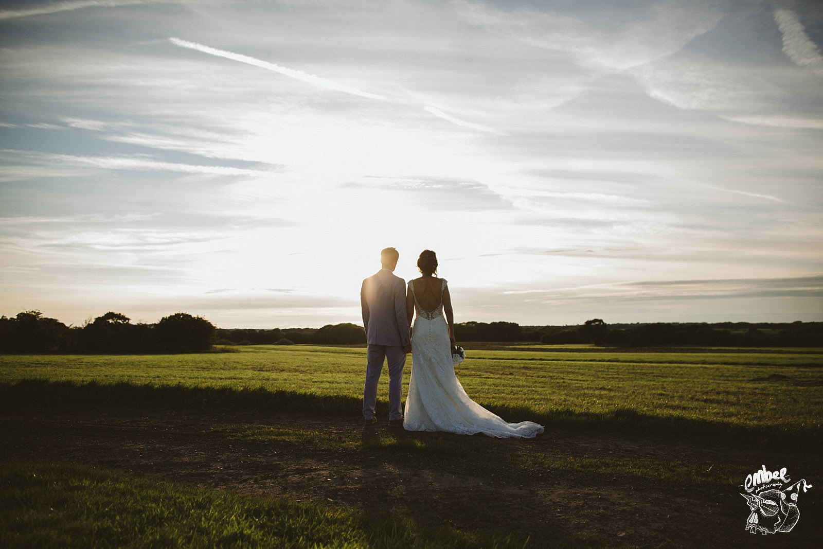 newlyweds look far into the landscape of lancashire