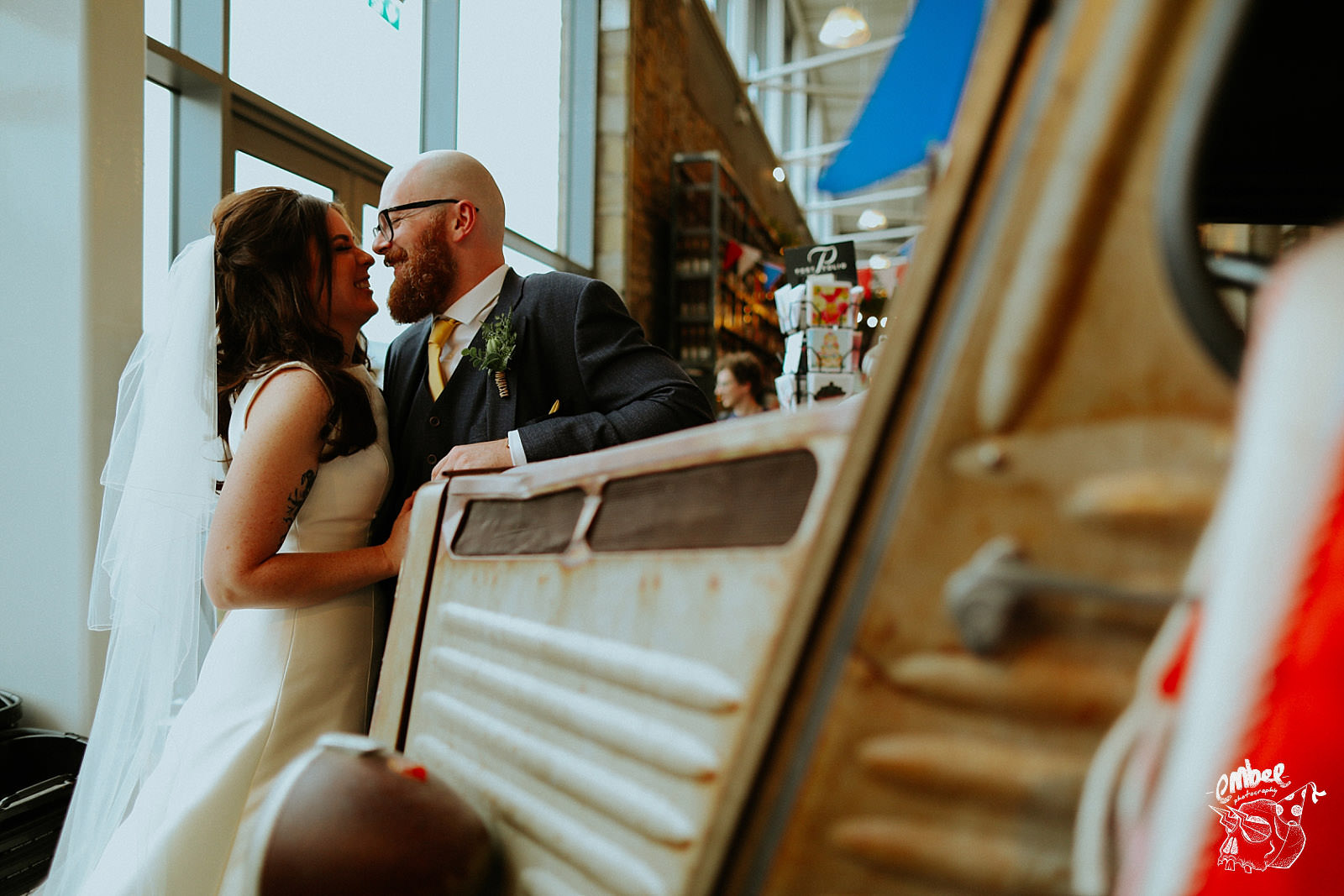 couple having wedding pictures in the food hall at holmes mill