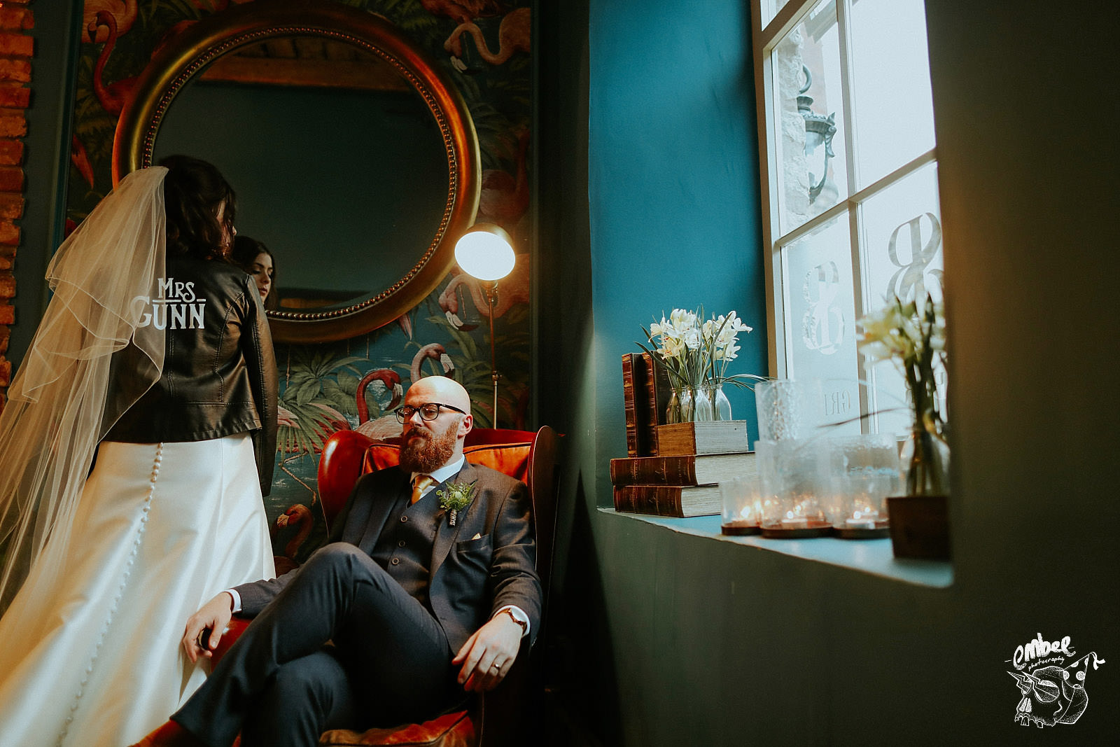 bride and groom pose inside holmes mill