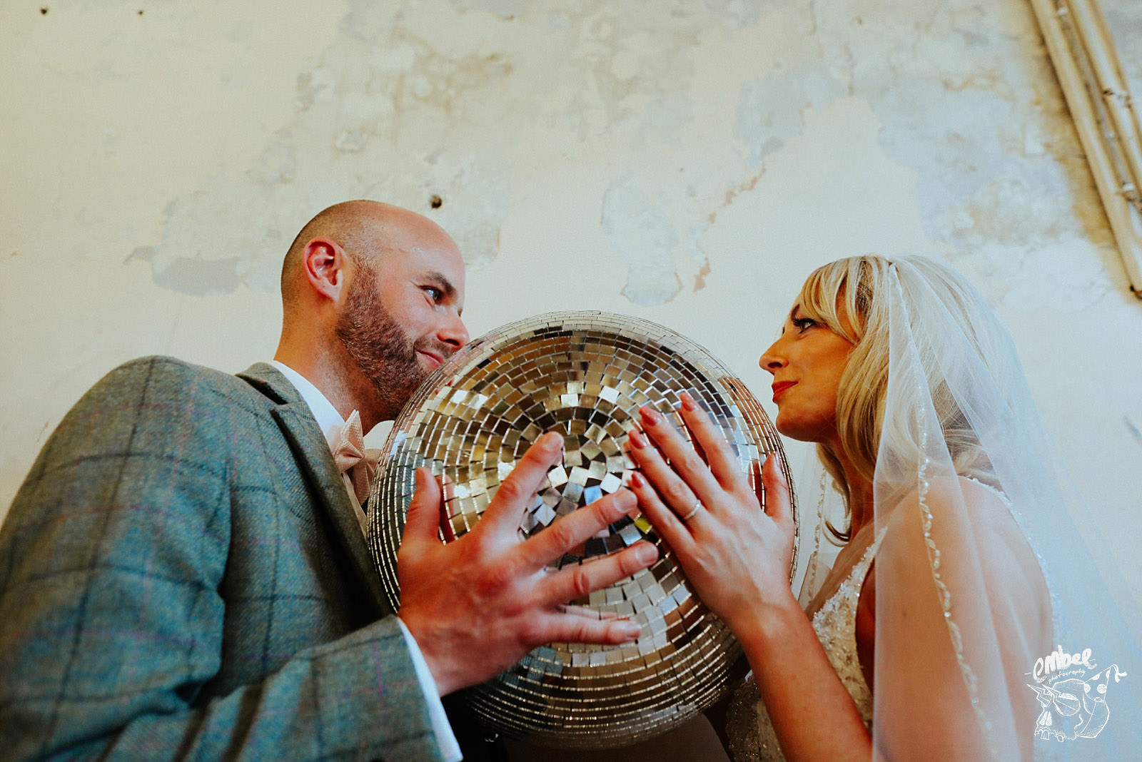 bride and groom hold glitter ball