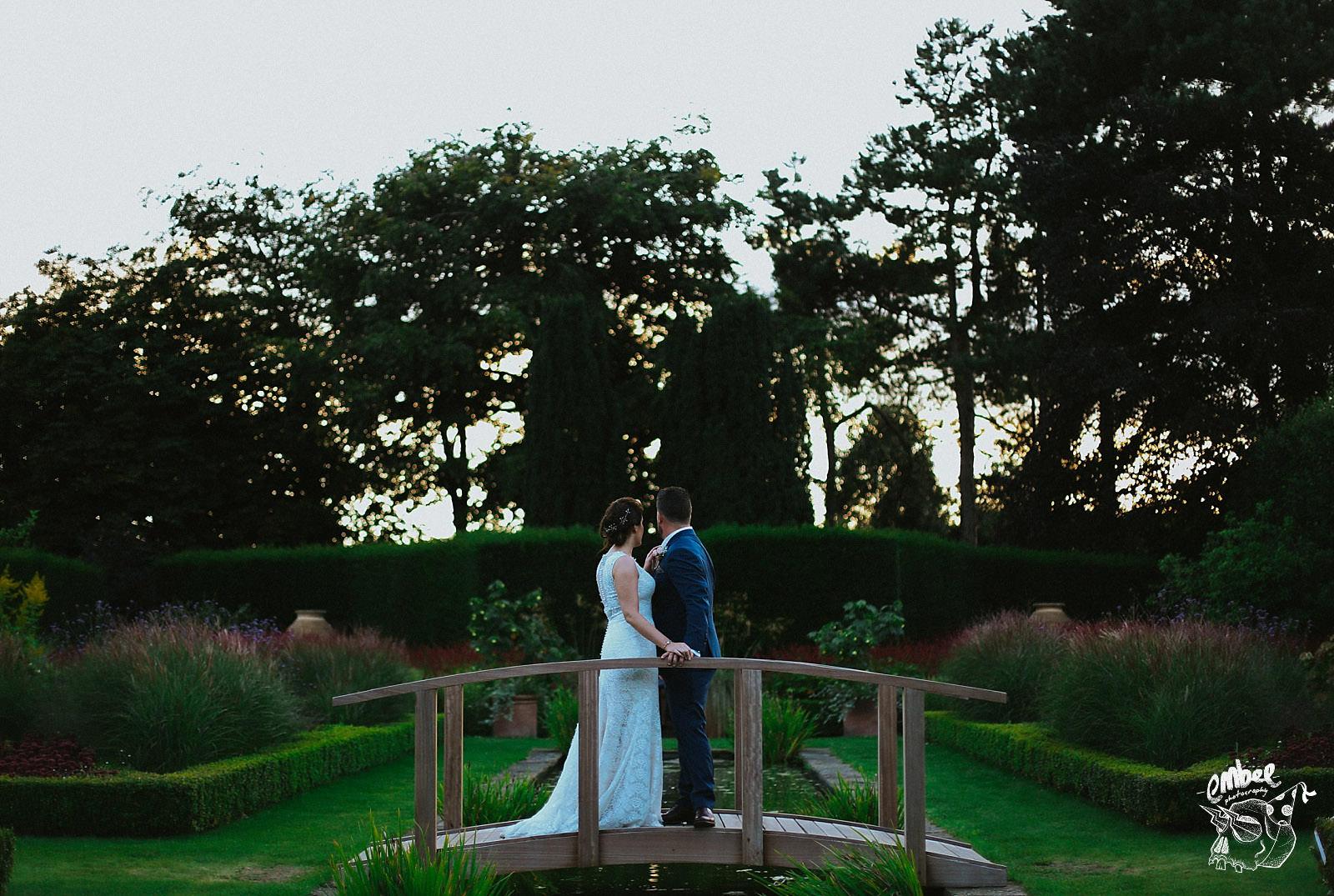 abbeywood estate wedding couple on the little bridge