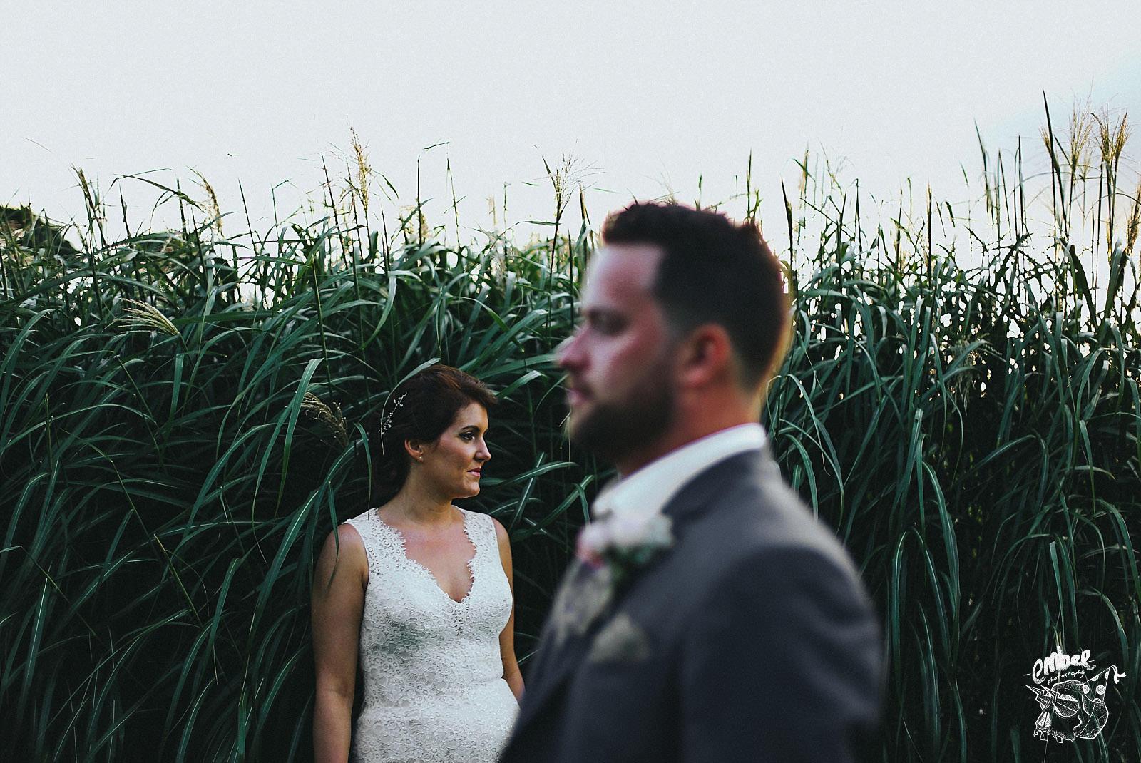 bride and groom looking opposite ways