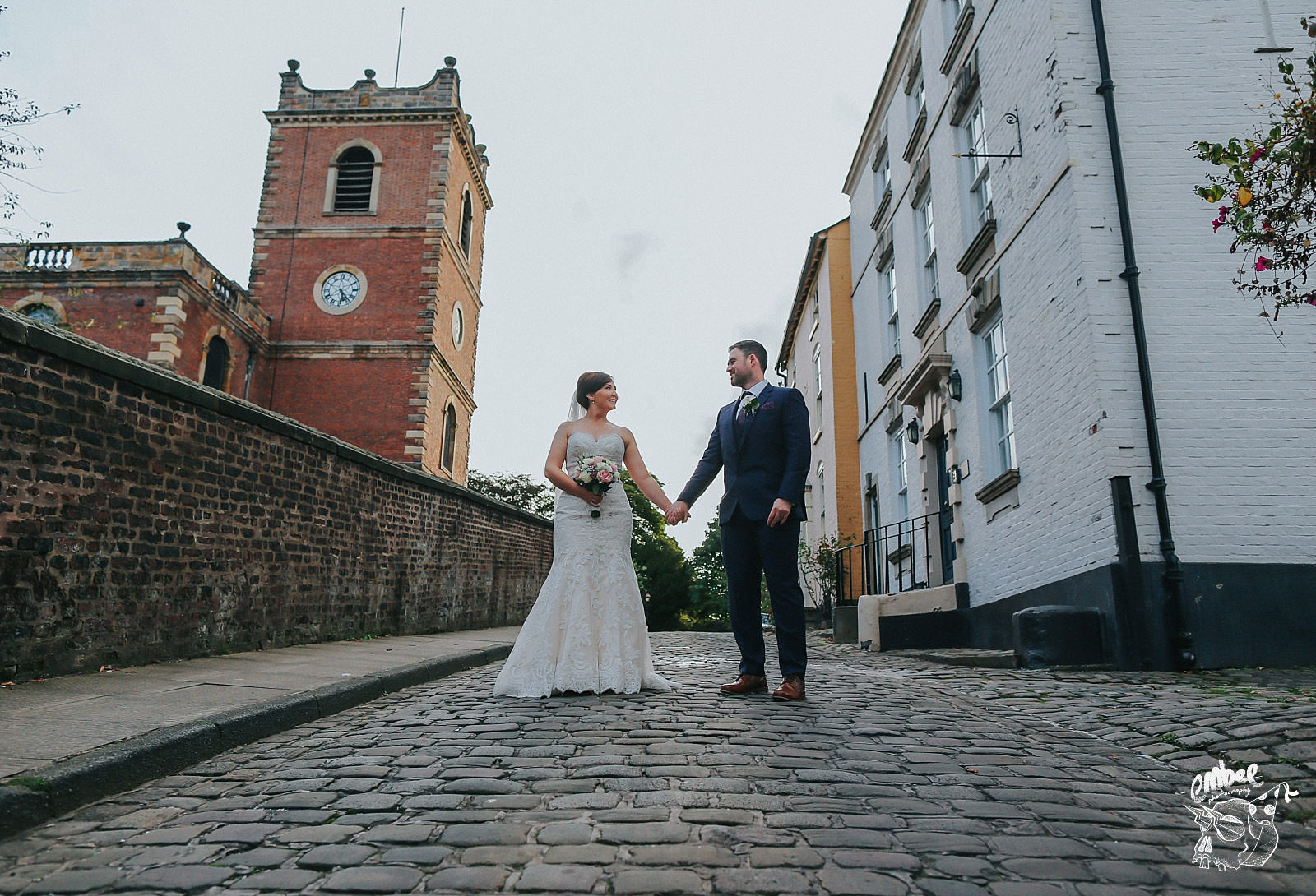 bride and groom in the middle of a cobbled street in knutsford