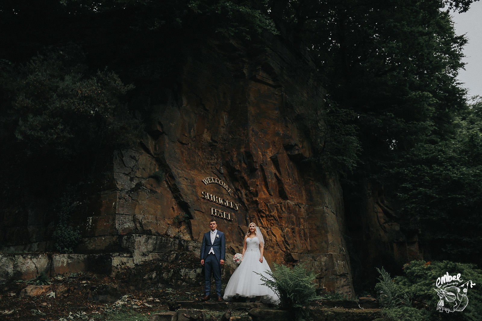 rock face at shrigley hall with bride under it