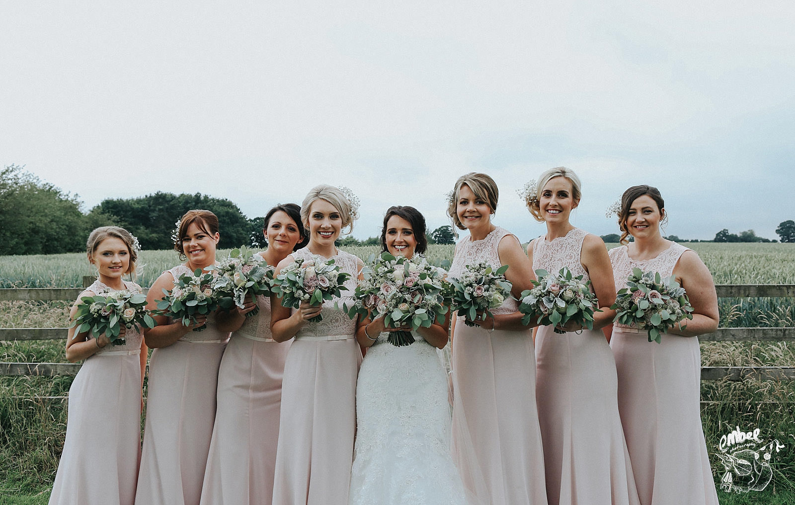bride and her bridesmaids at sandhog oak barn