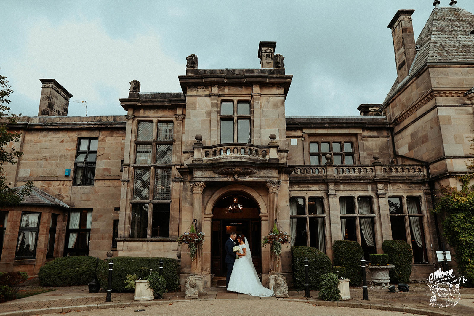 wedding couple in front of rookery hall in cheshire
