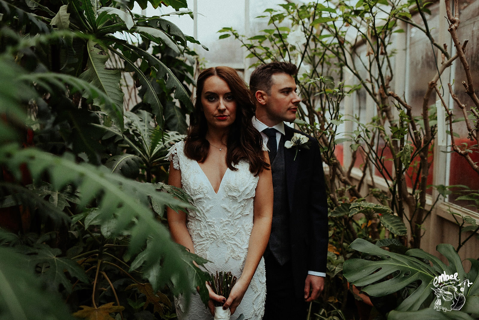 artistic shot of the bride and groom in the abbey wood estate greenhouse