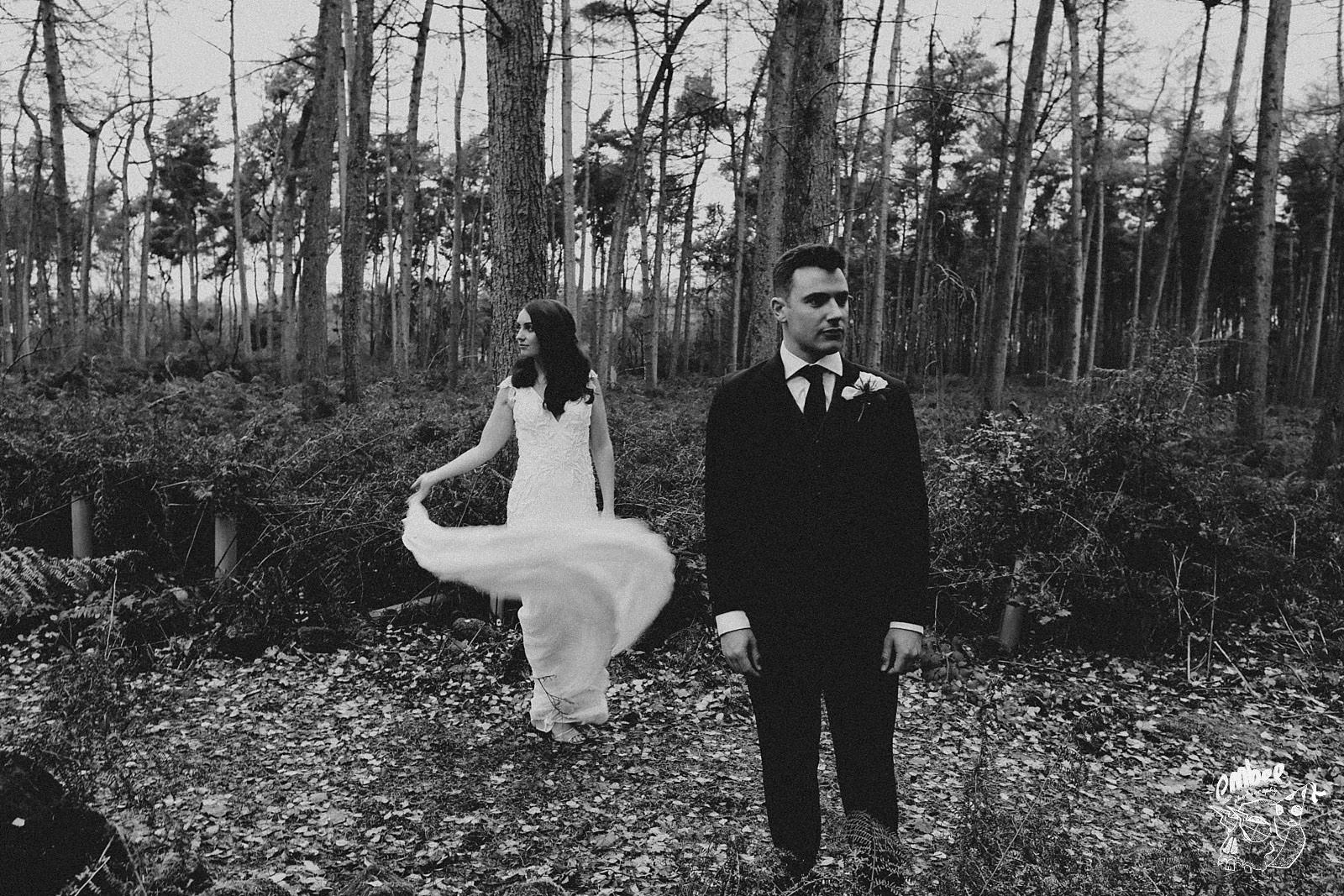 bride and groom in the forest of abbey wood estate