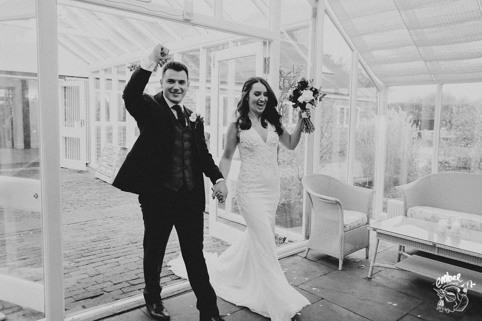 bride and groom walk in the wedding breakfast at abbey wood estate