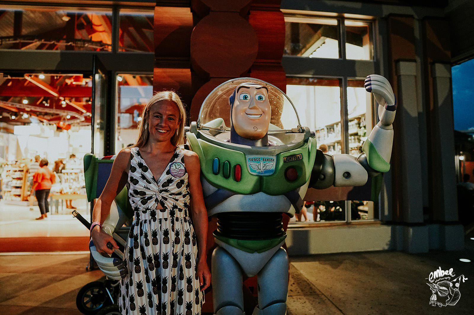girl has a picture with buzz lightyear