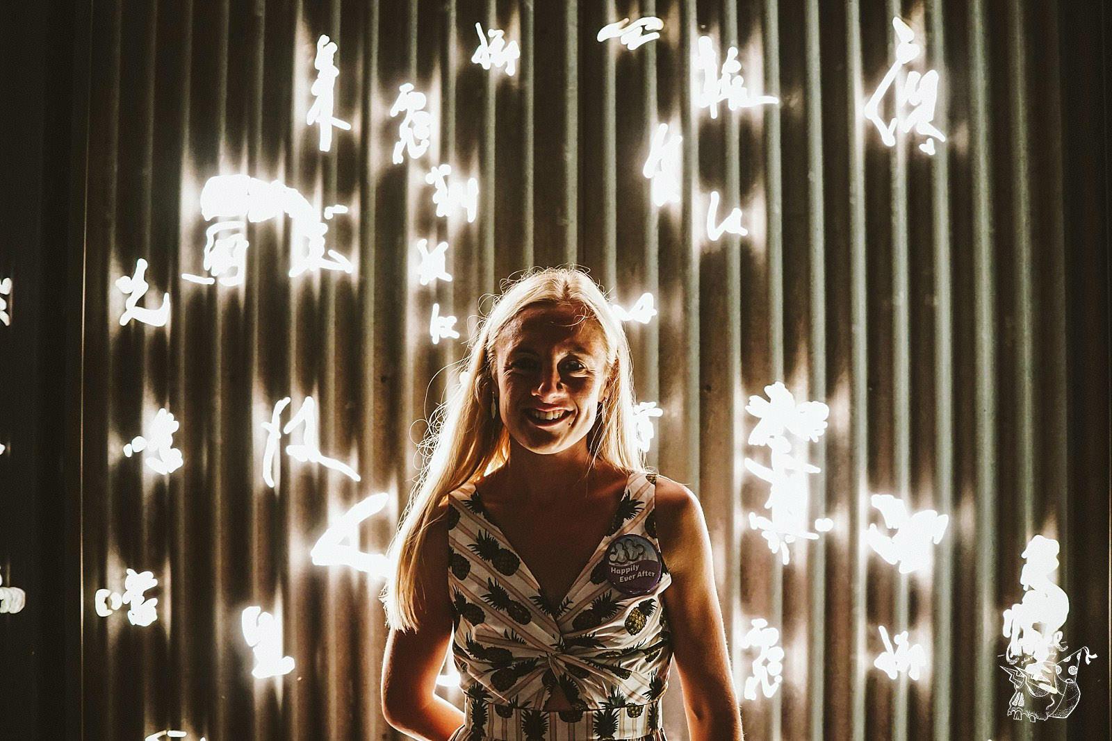 girl infront metal lights
