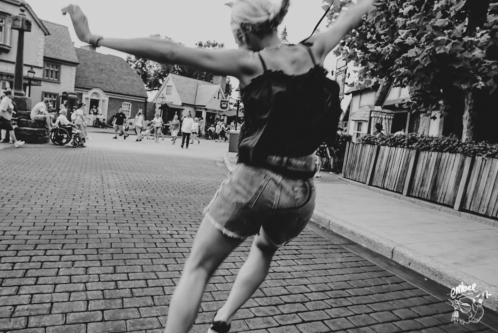 girl jumping in the street