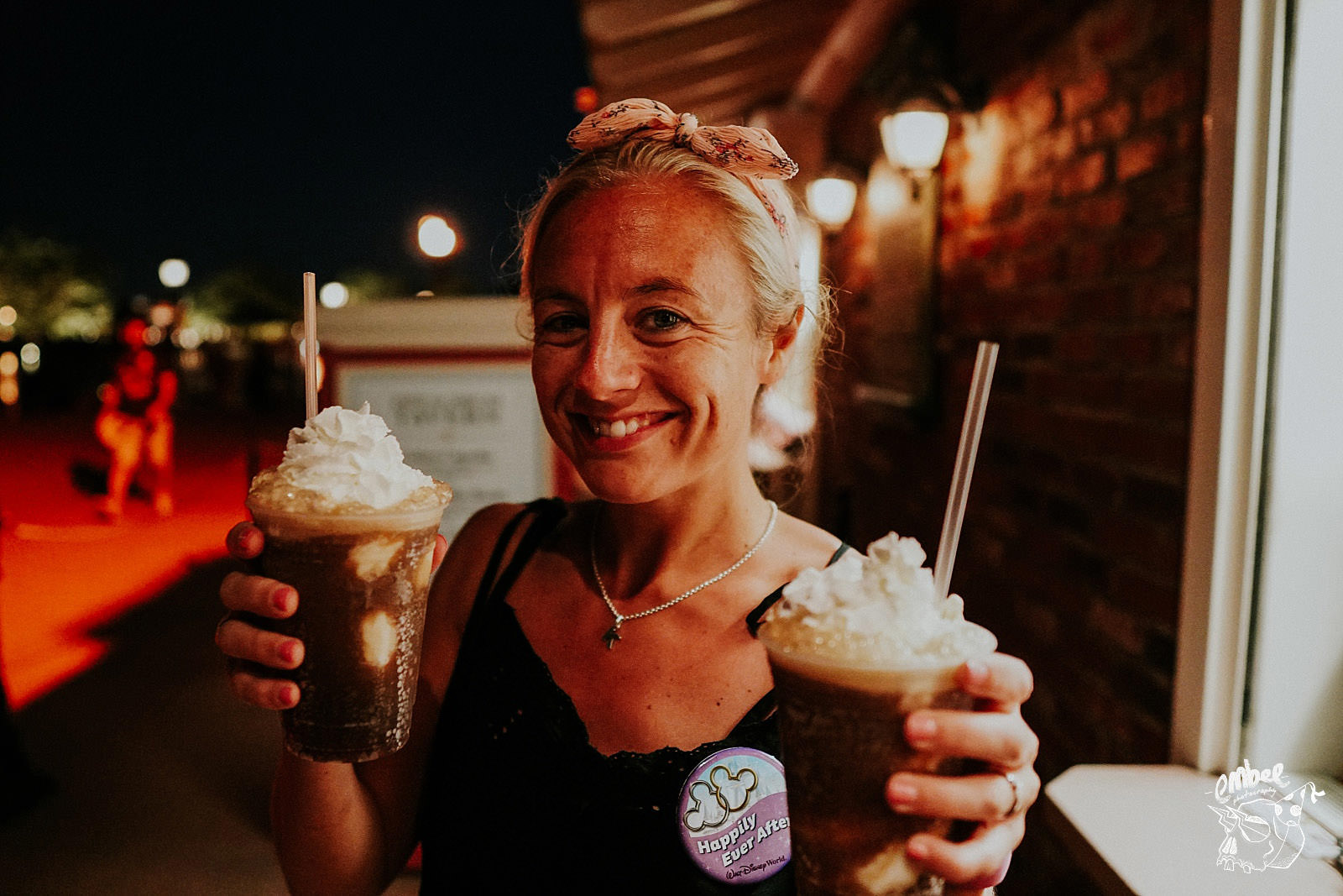 girl holding two root beer floats