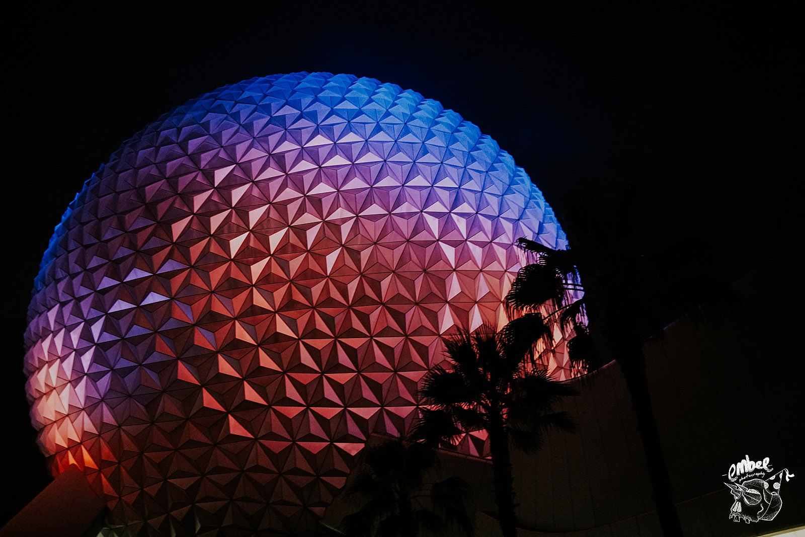 epcot spaceship earth lit up at night