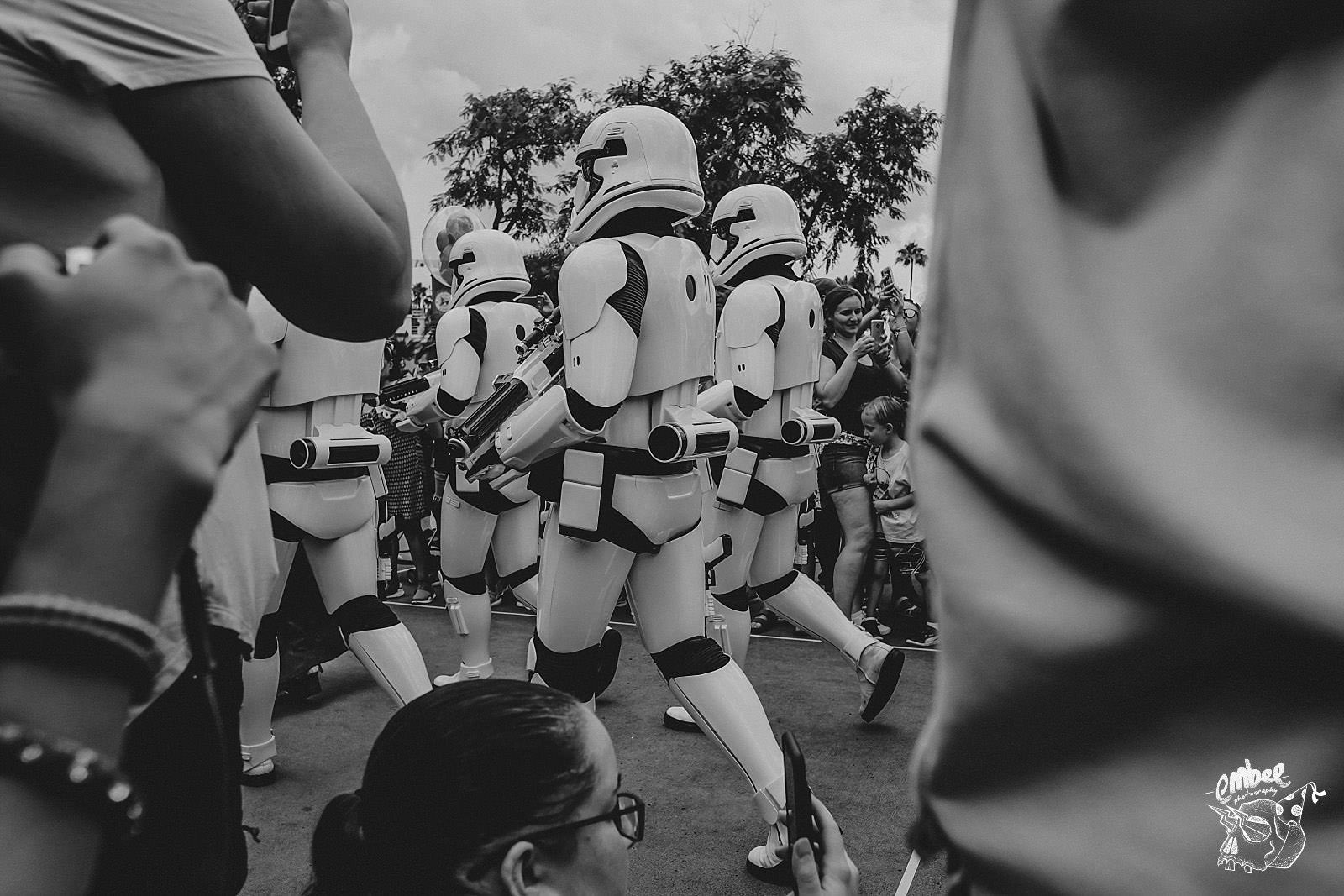 storm troopers walk through people at hollywood studios