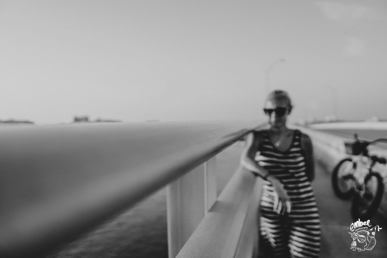 art shot of girl on bridge