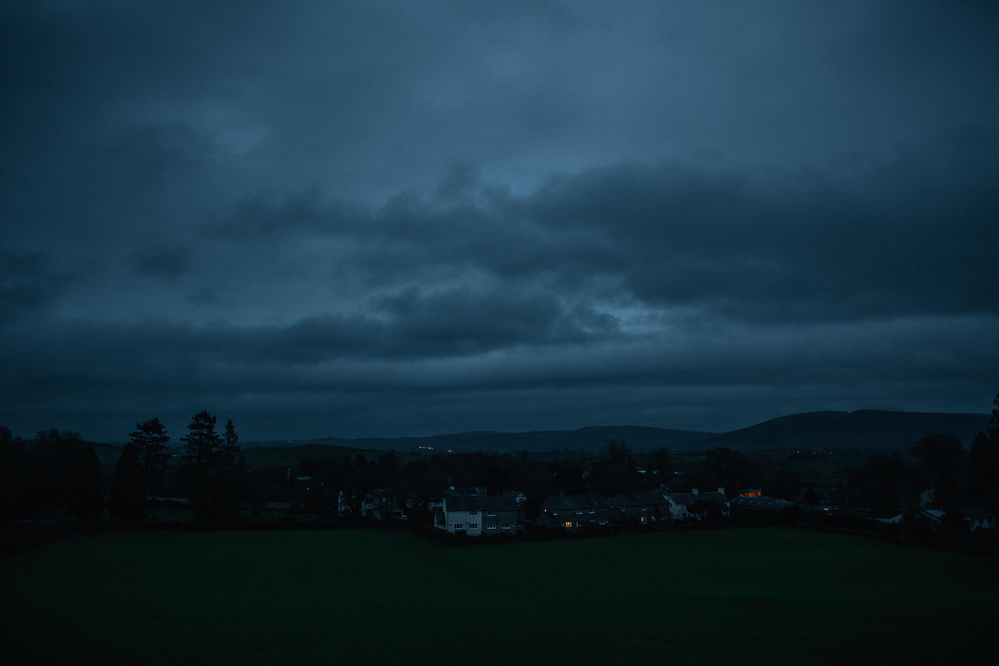 a view over the town of beetham in Lancashire at dusk