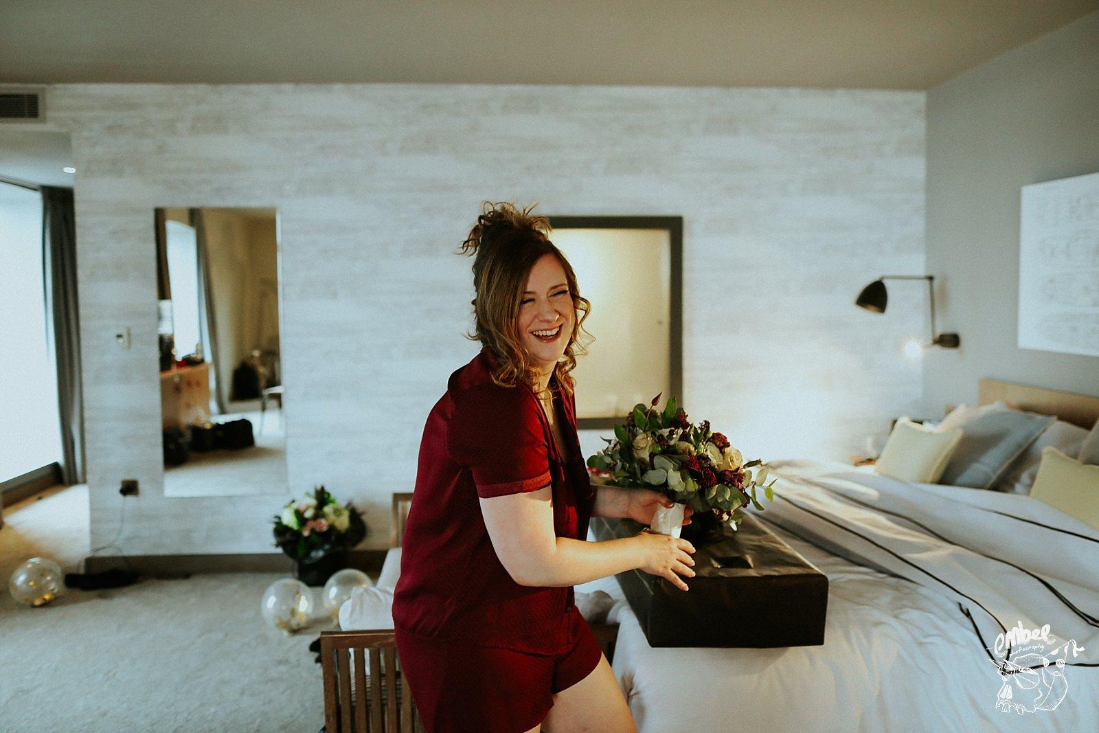 bride in pyjamas with flowers