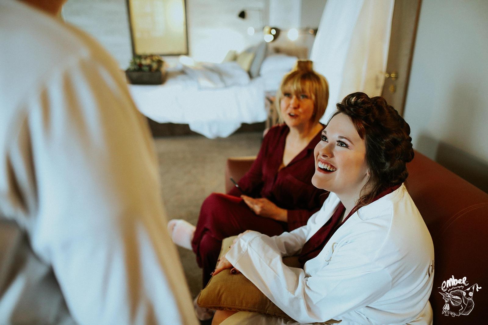 bridesmaid laught during bridal prep