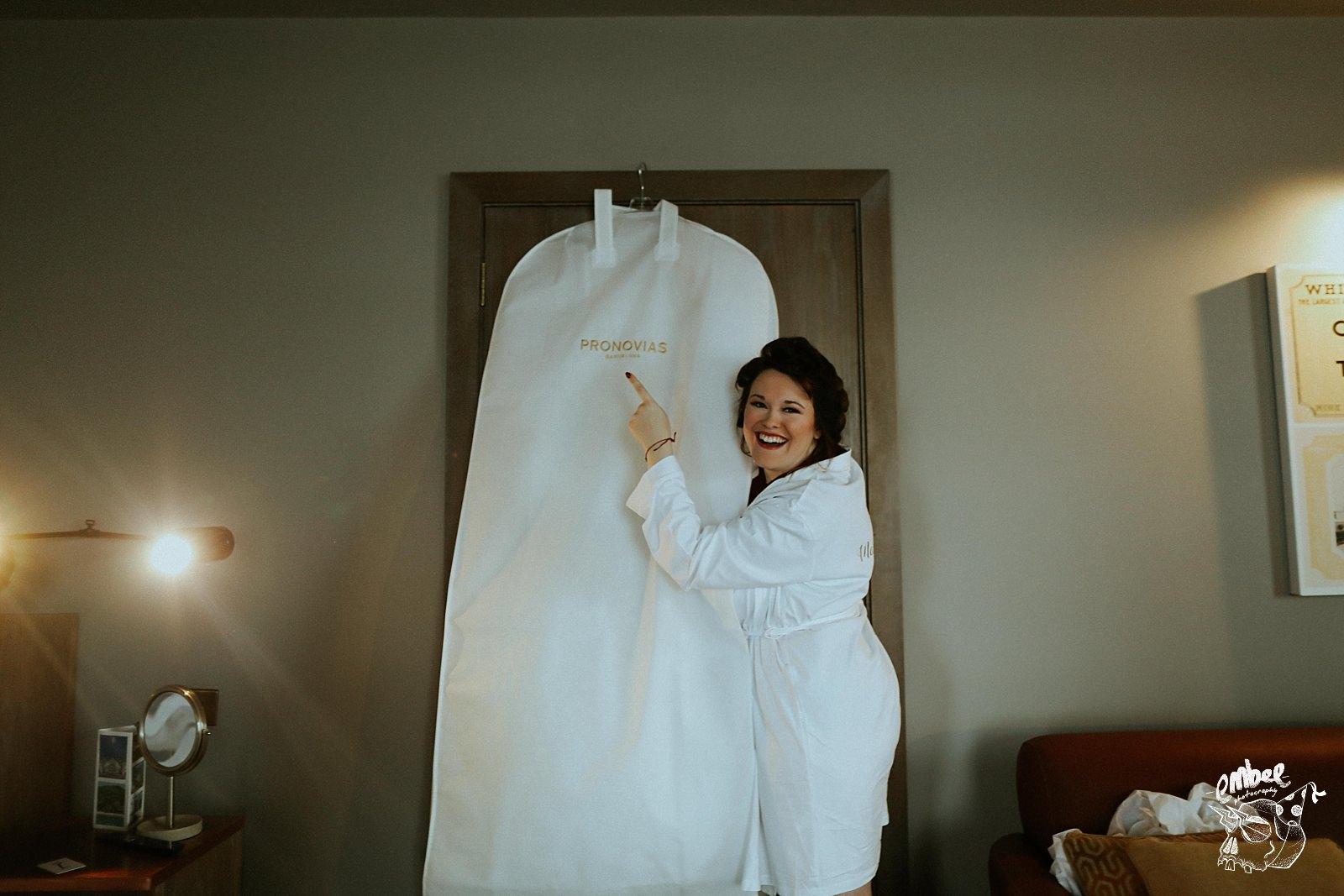 bridesmaid holding wedding dress