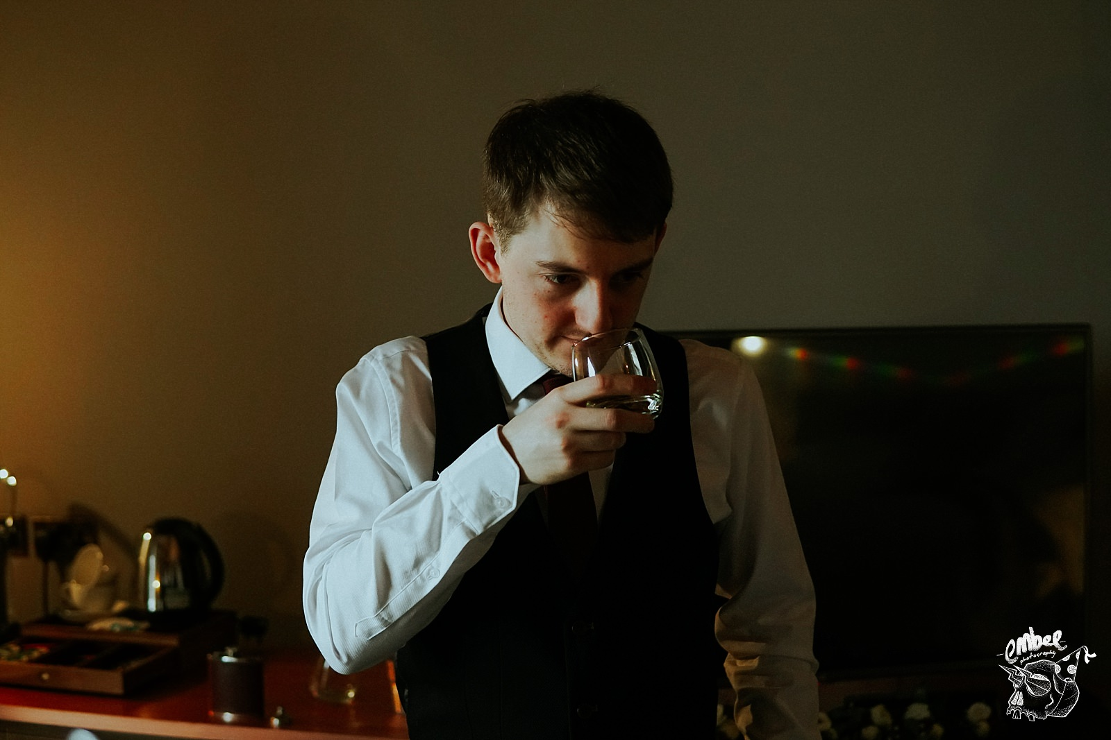groom smelling whisky