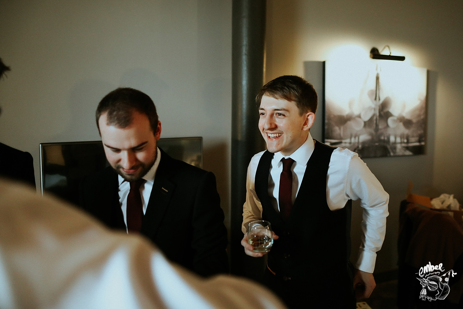groom smiling with whisky in hand