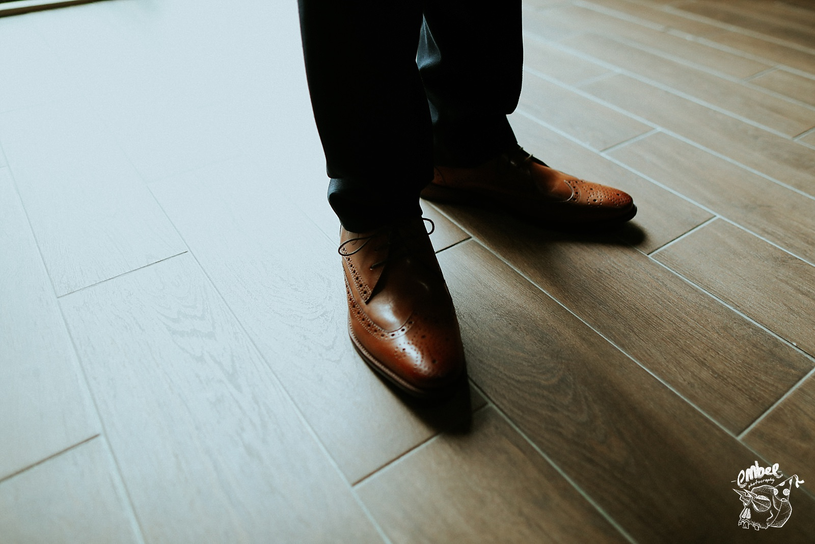 creative shot of grooms shoes