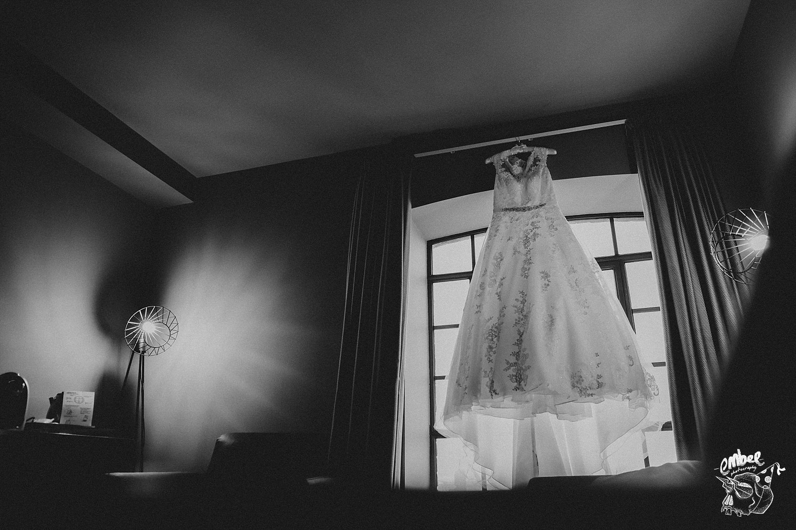 pronovias wedding dress hung up infront on industrial window