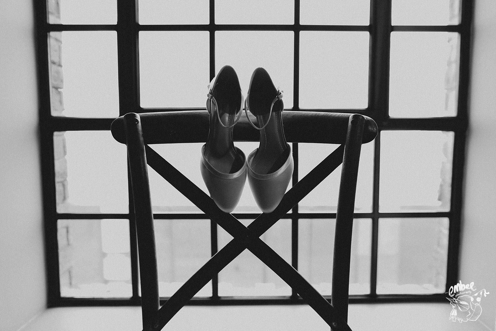 brides wedding shoes on a chair