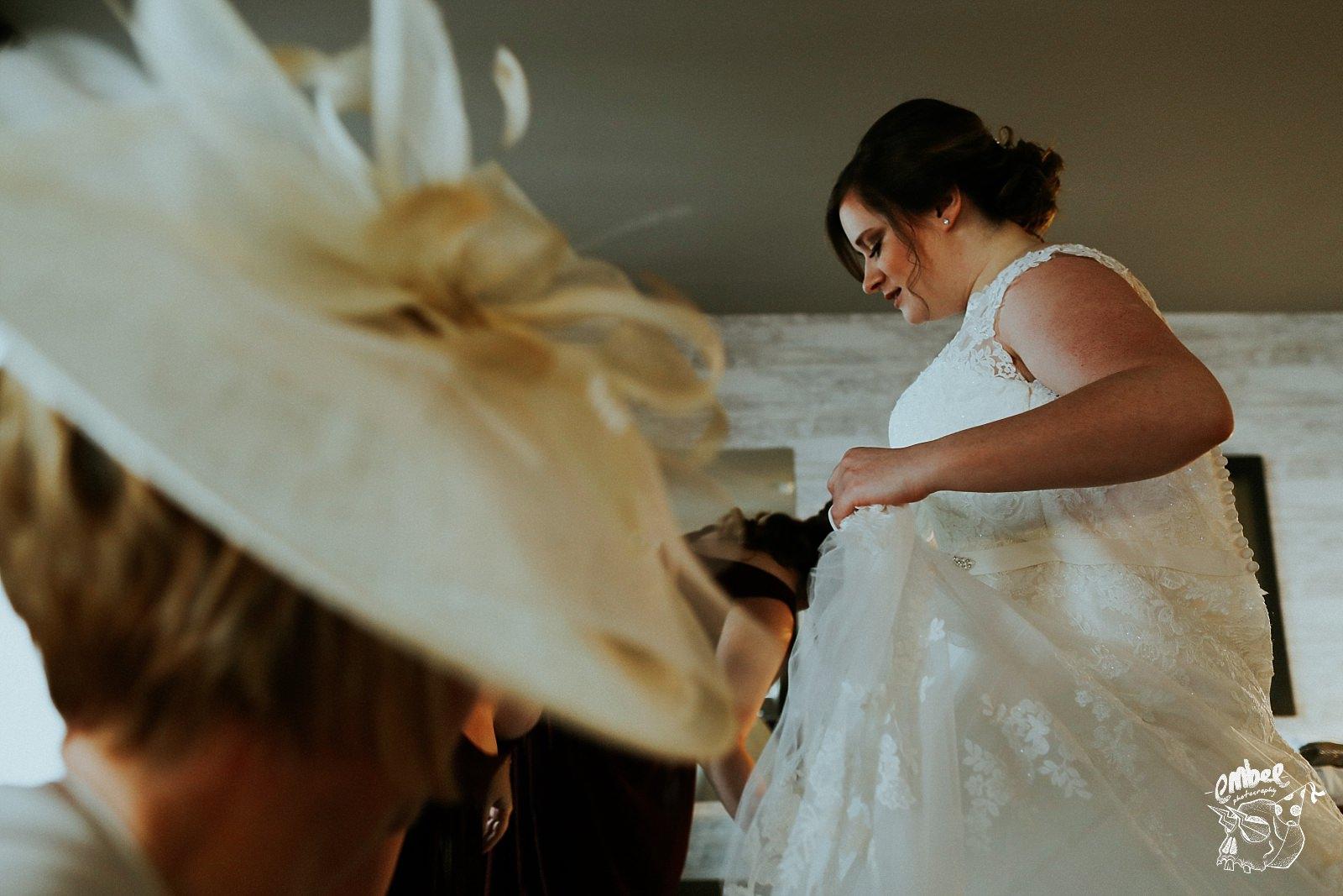 bride lifting her dress up