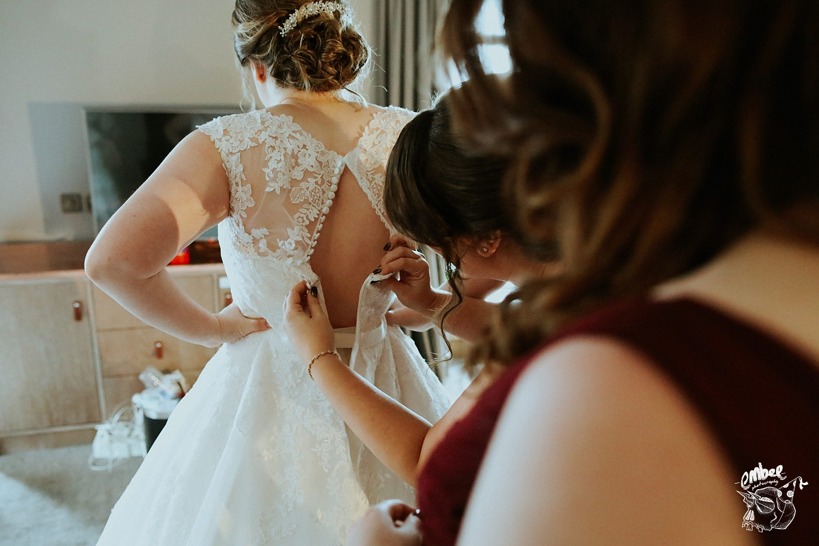 buttoning up the brides dress