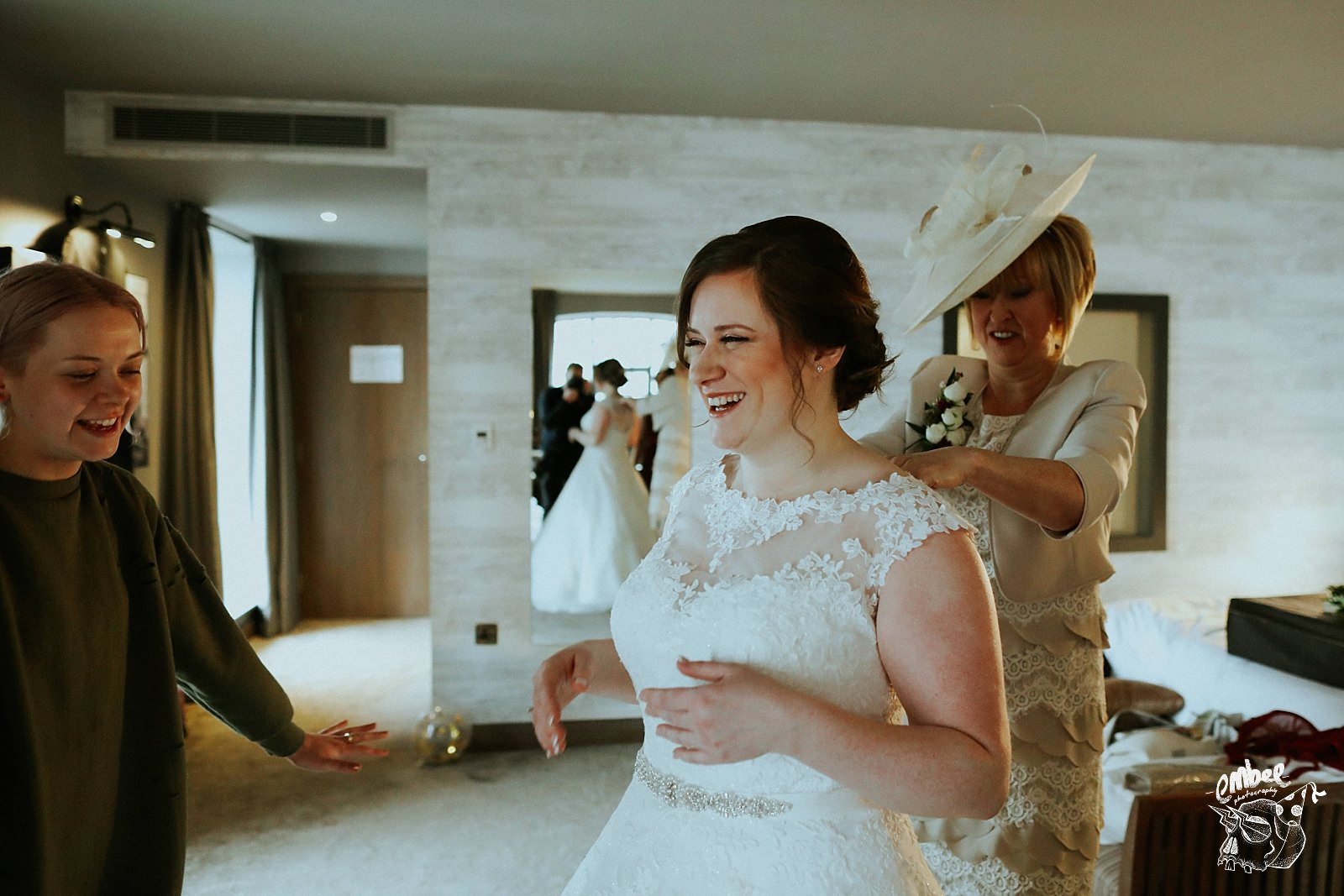 bride laughing in lace wedding dress