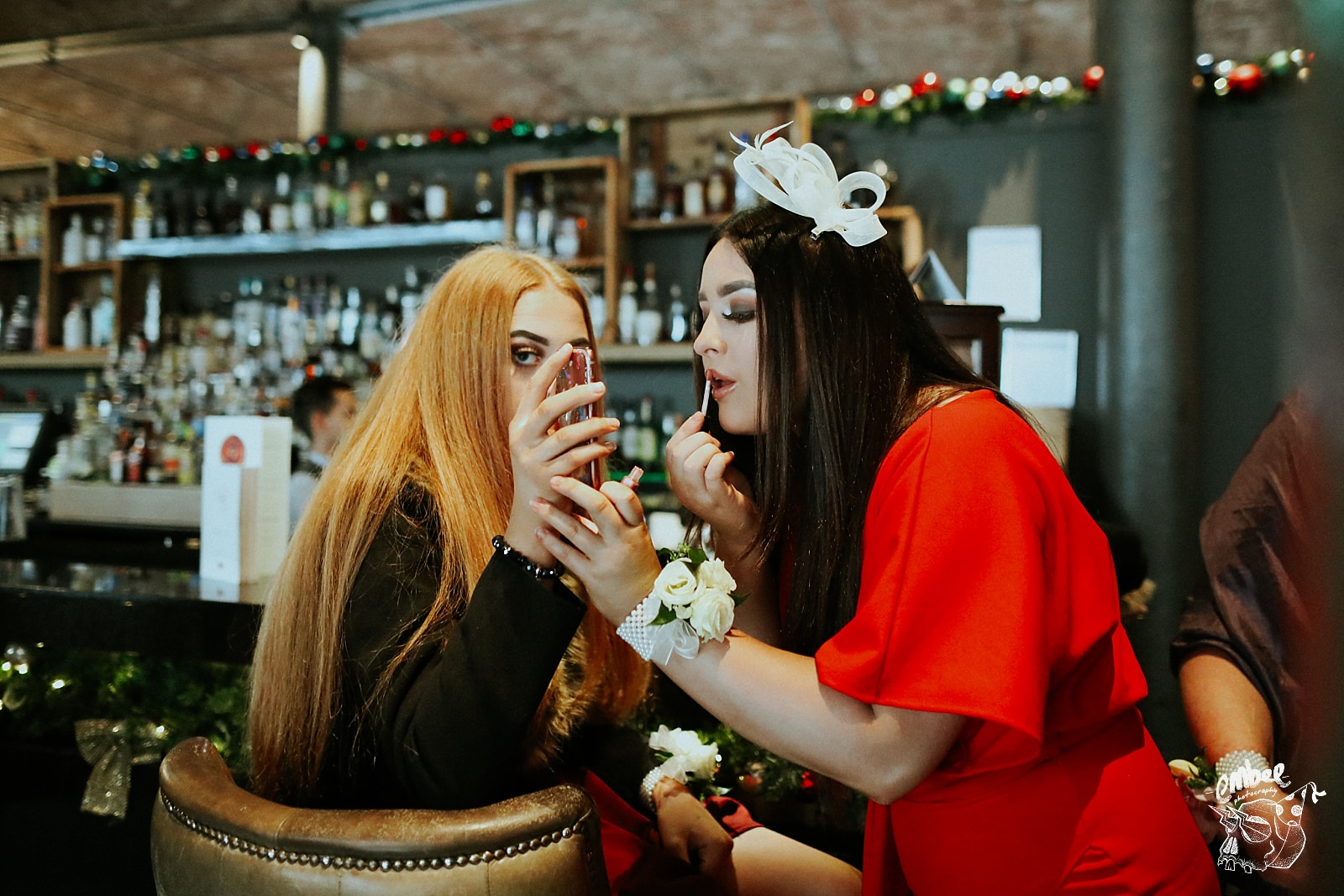 wedding guests doing each others make up