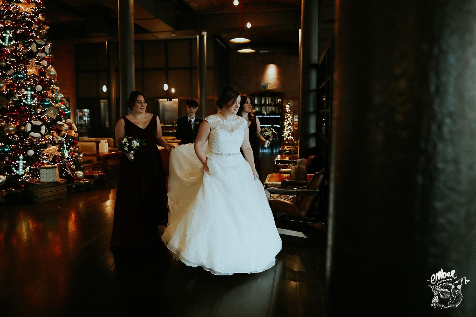 bride walking through hotel lobby