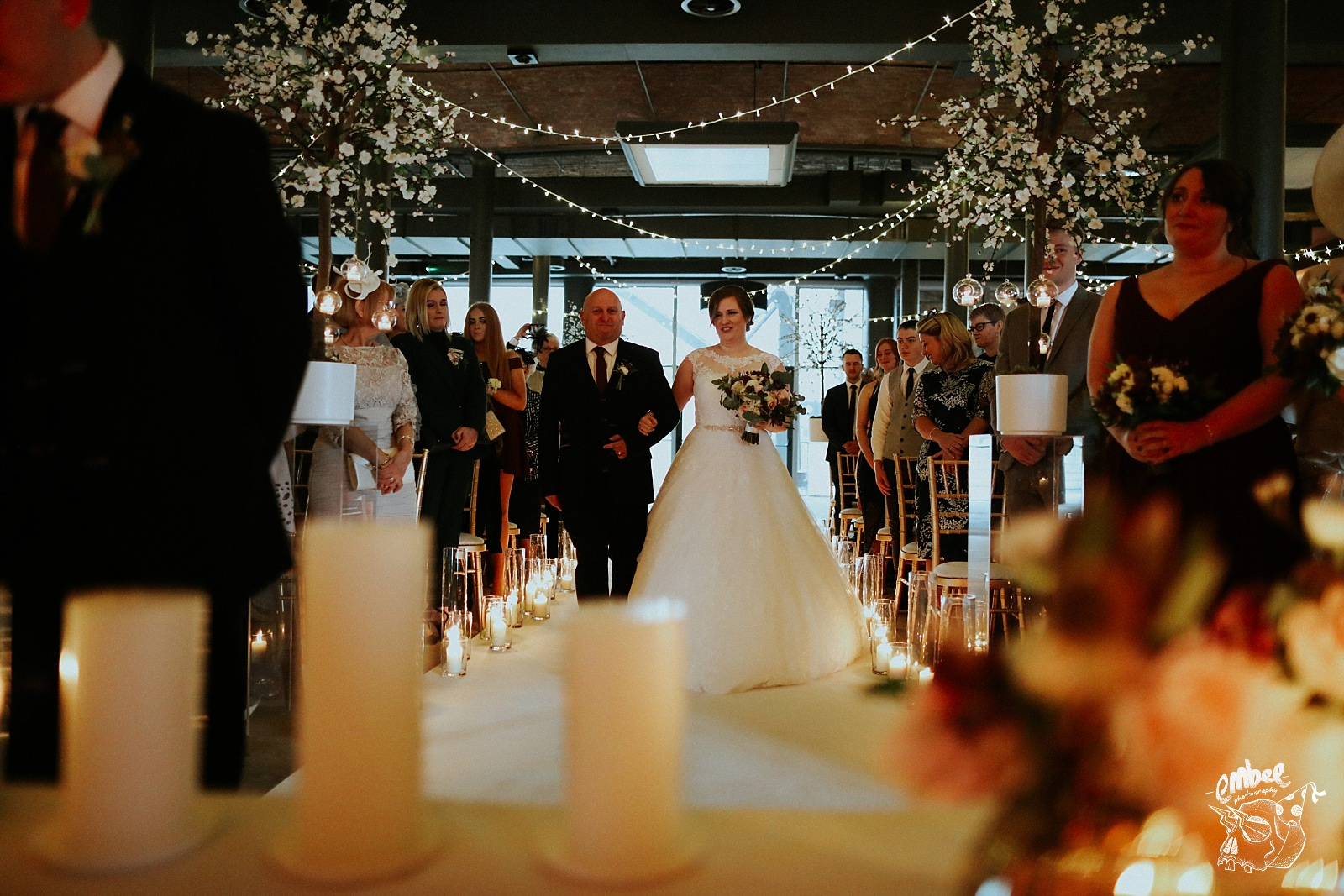 bride and dad walk down the aisle at titanic hotel