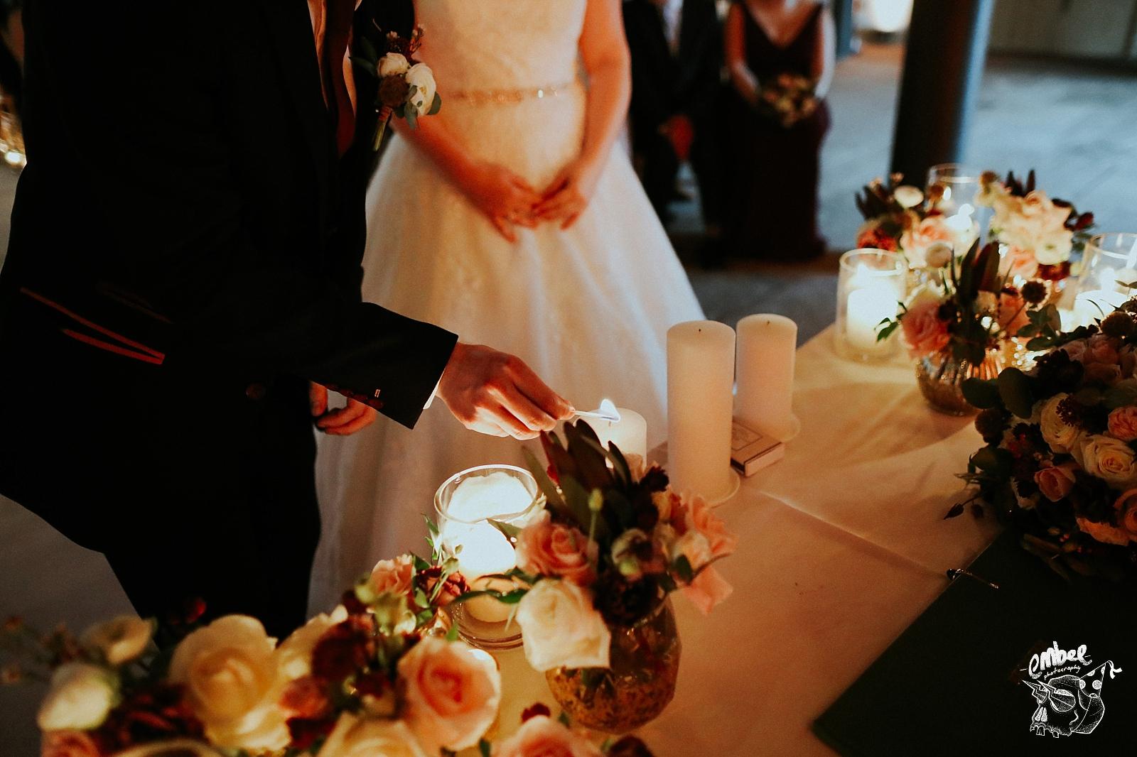 groom lighting candle