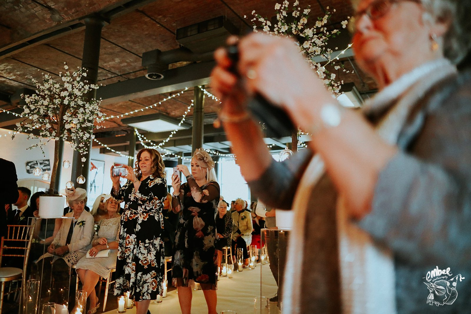 guests take pictures of the bride and groom