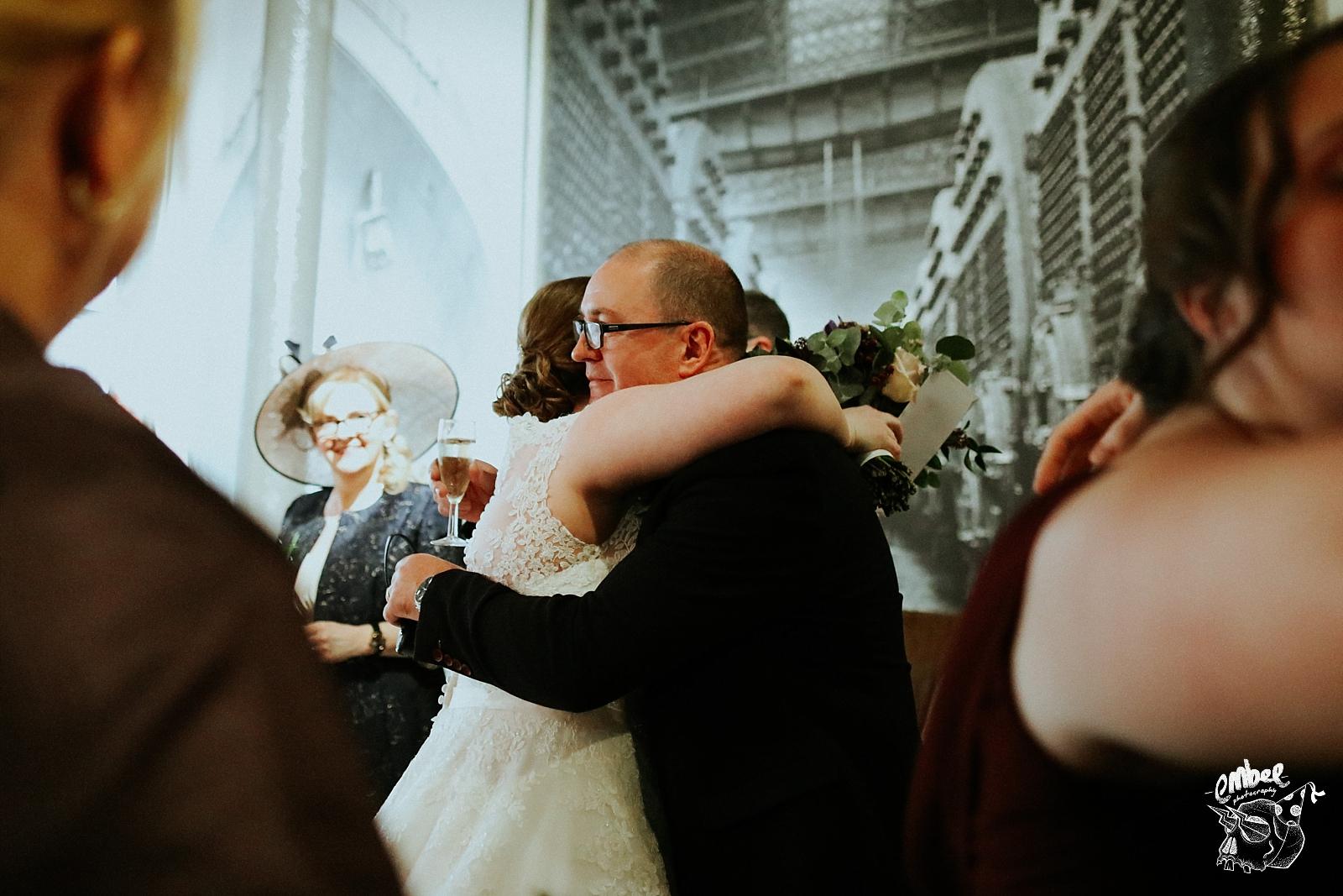 man hugs bride after getting married