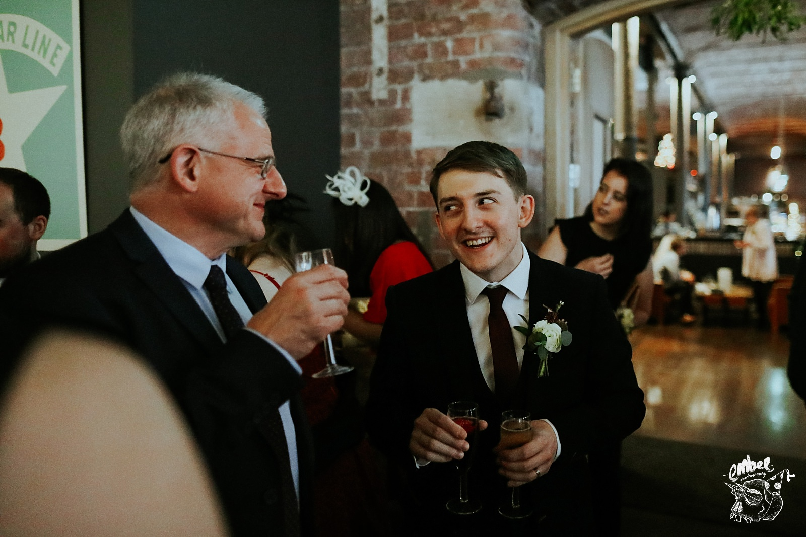 groom laughing with guest