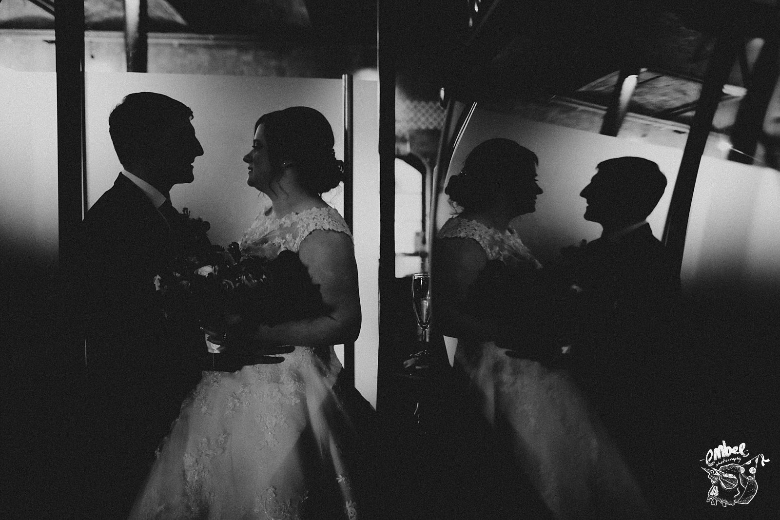 artistic shot of bride and groom with reflections
