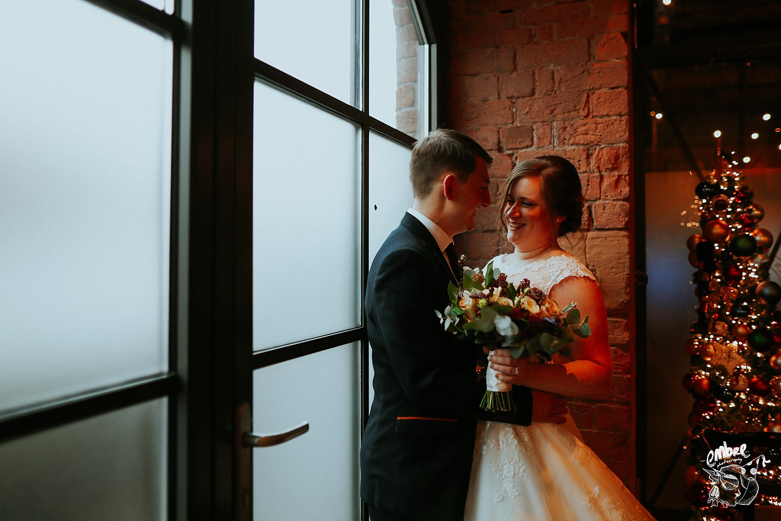 bride holding flowers with her husband