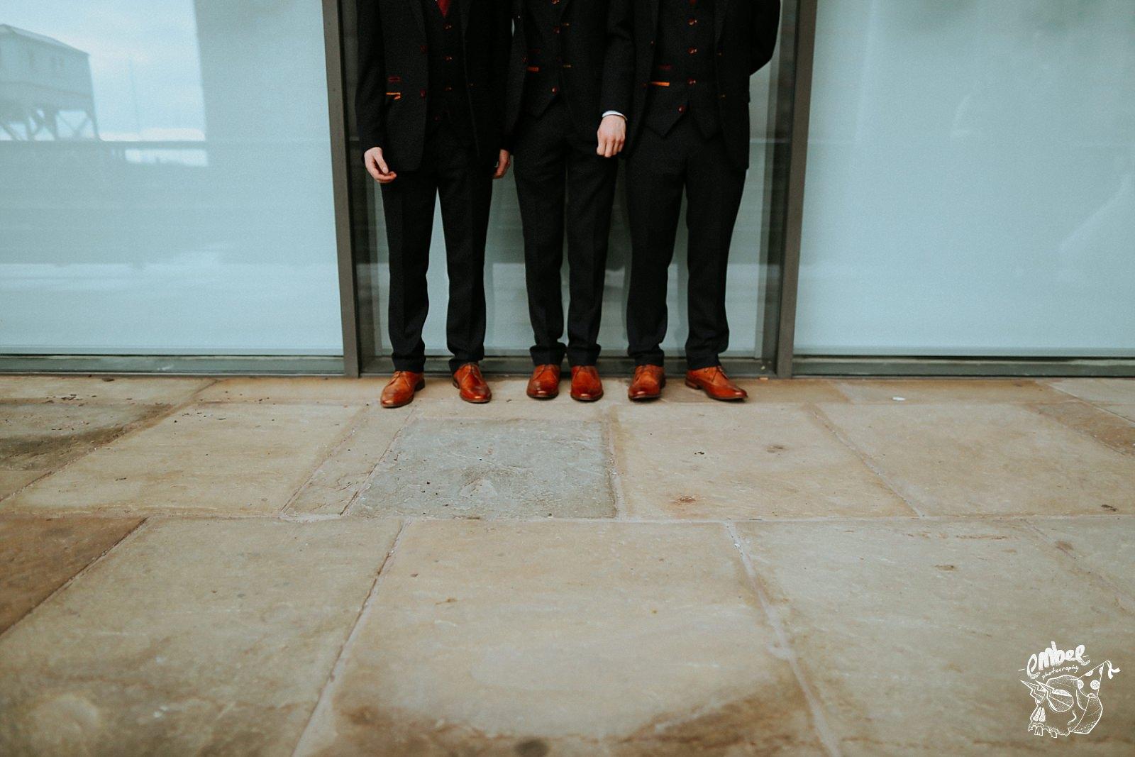 groom and ushers shoe image