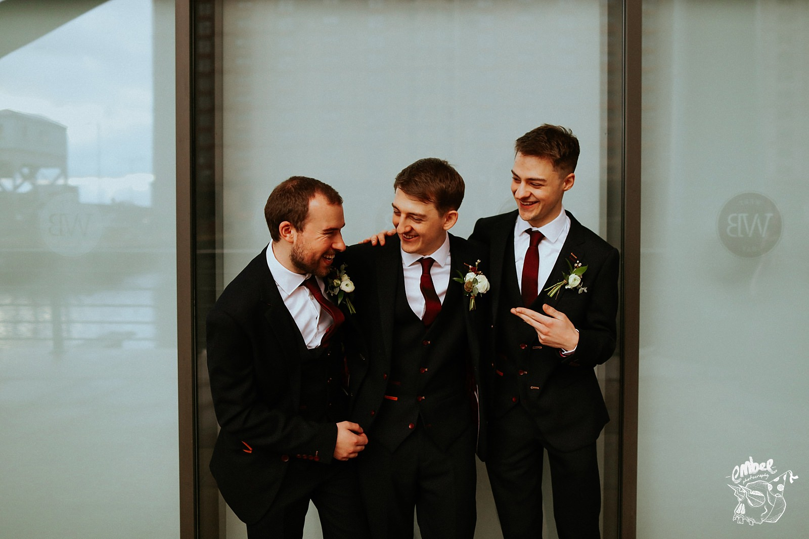 groom with ushers joking around