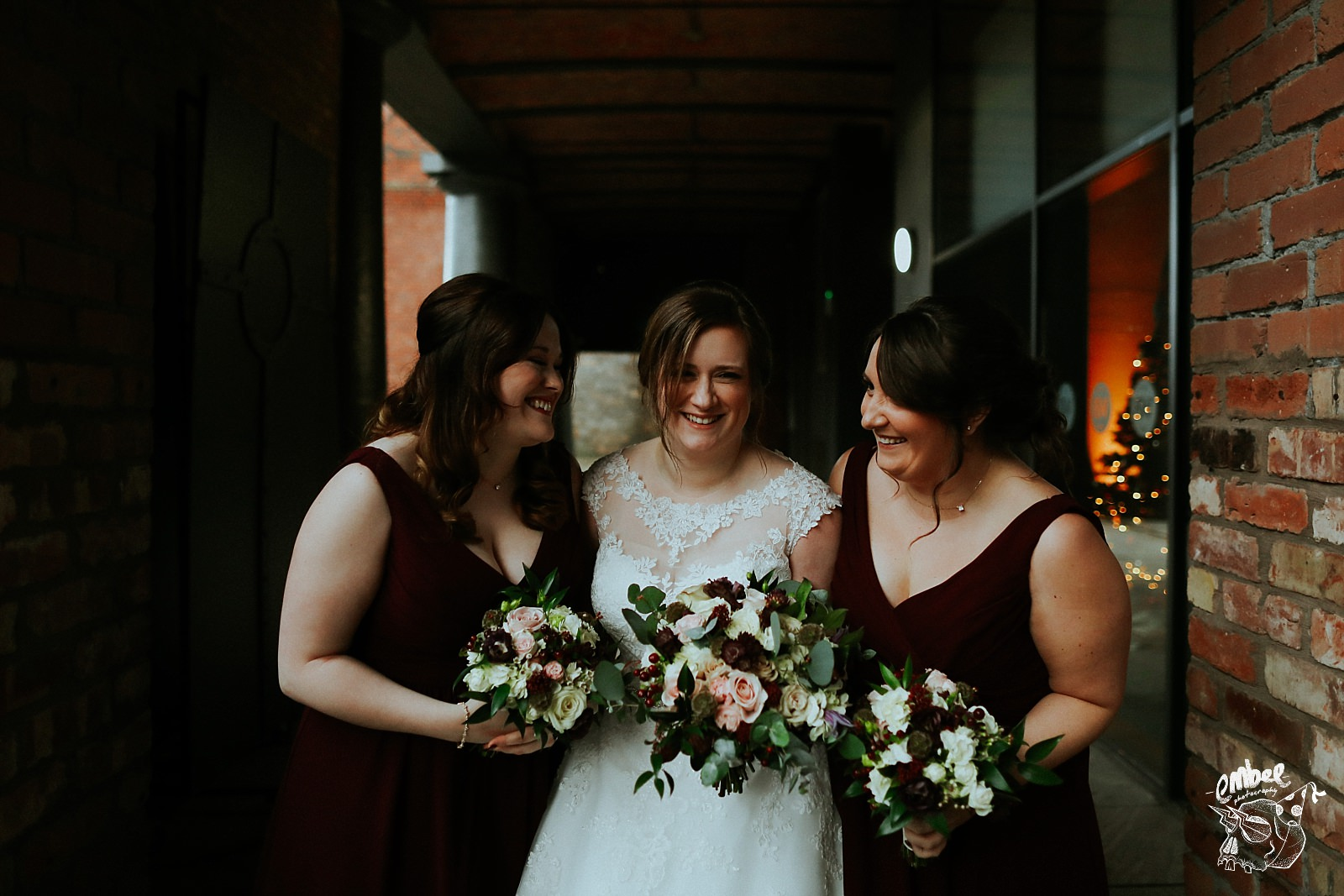 bride and bridesmaids holding flowers