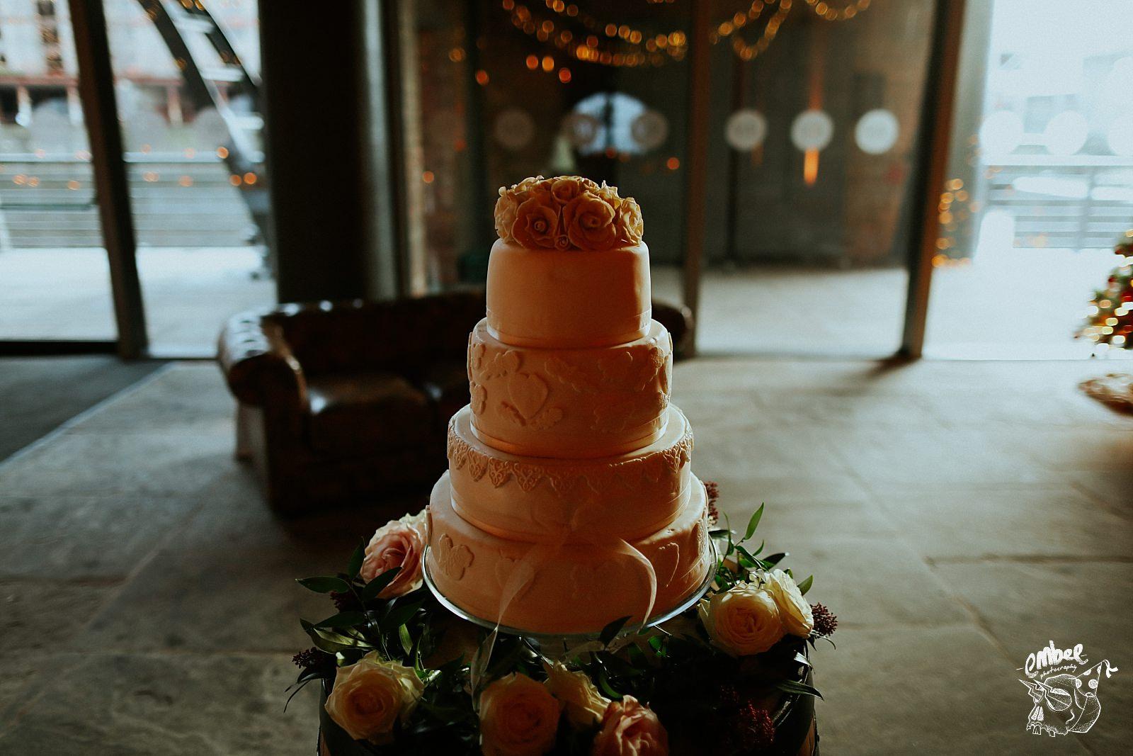 wedding cake being illuminated by a sunset